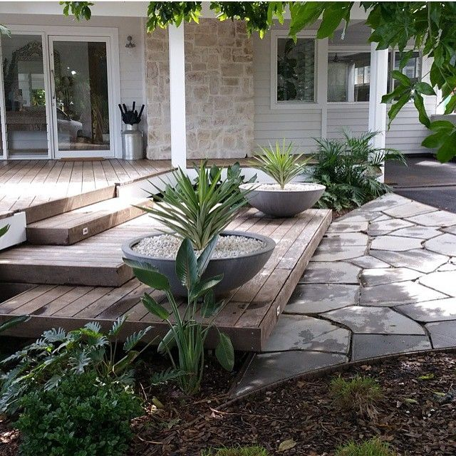 The Grove at Byron Bay - sandstone, decking, paving and pots. Alfresco and porch idea.