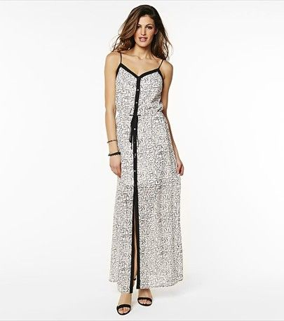 This maxi dress with a unique button down placket is a must-have for summer days!