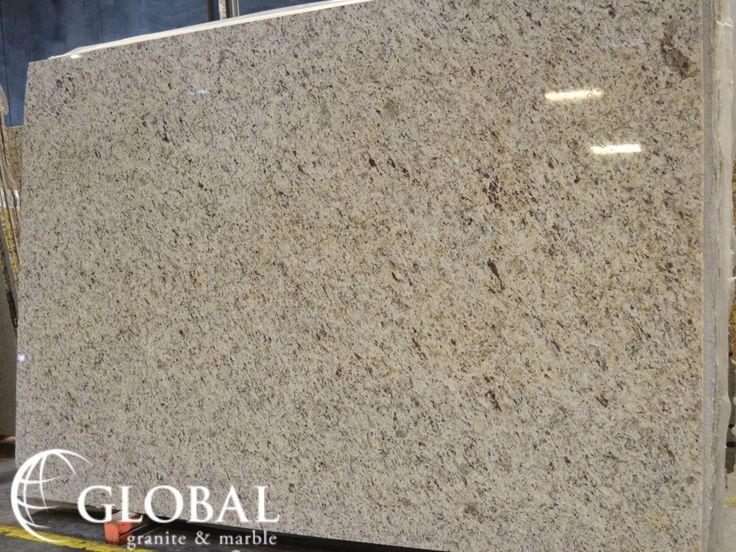 Giallo Verona polished granite slab. Visit globalgranite.com for your natural stone needs.