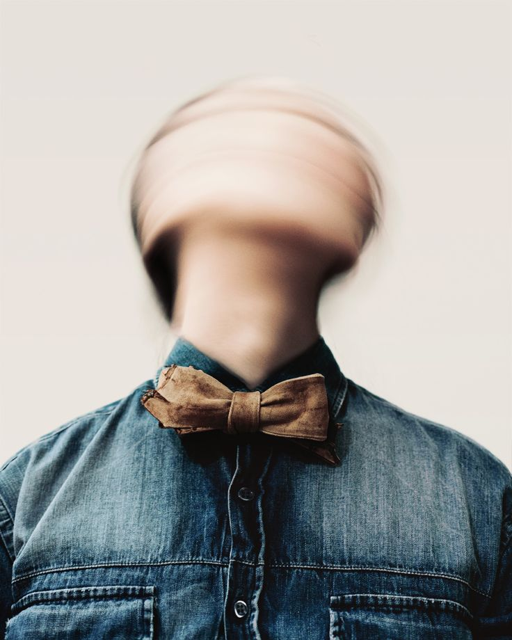 The way that the head is blurry shows that the picture was taken when the person was in motion.  It adds the idea of movement to a still picture.