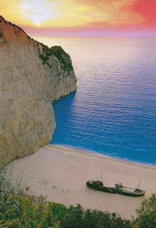 Sunrise at Navagio beach.  Zakynthos island, Ionian Sea, Greece