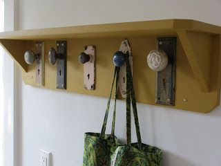 antique door knobs used as hooks for a rack--with shelf