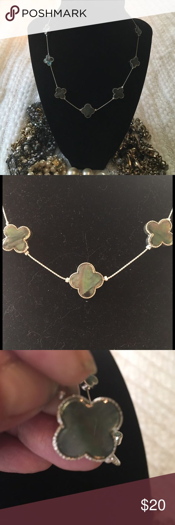 Costume Silver Plated Mother of Pearl Necklace Very dainty yet elegant 16 inch silver plated cloverleaf design costume mother of pearl necklace. The mother of pearl is a beautiful color gray-ish pink green depending on how the light hits it, it is on both sides of the clover as shown in the picture above & it has an extender so it can go up to 18 inches. As much as I ❤️ layering I wear this necklace by itself BC the mother of pearl especially in the light has such an impact it's beautiful…
