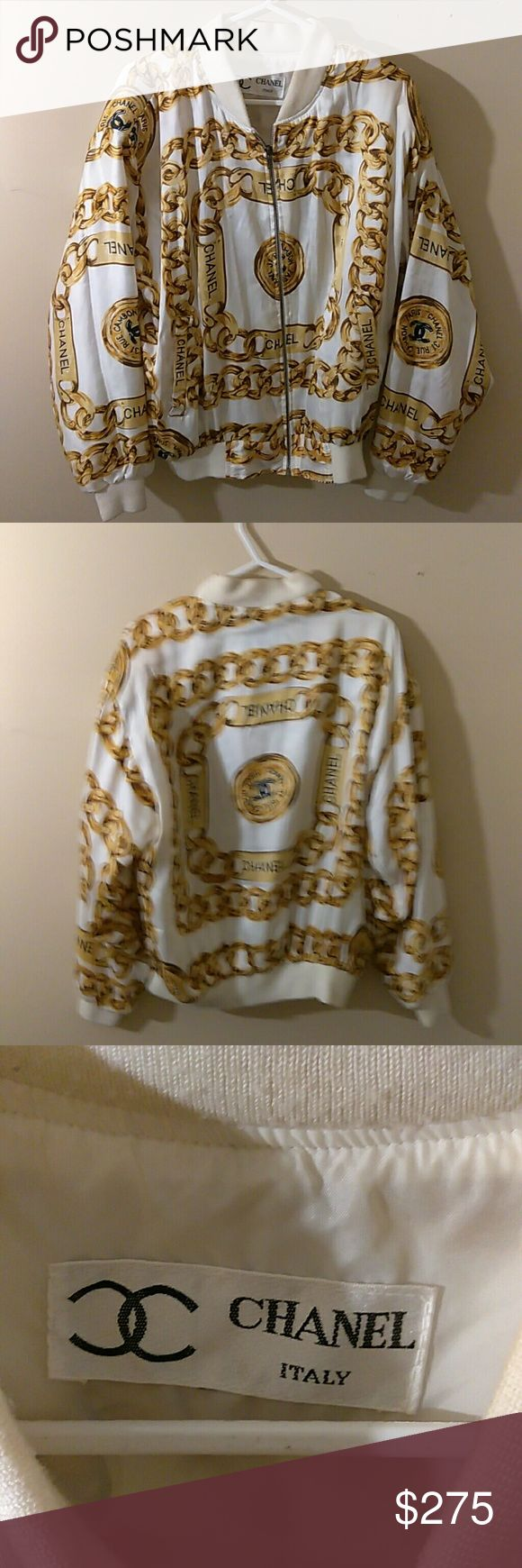 FLASH SALE  VINTAGE CHANEL GOLD CHAIN JACKET. Hard to find Chanel silk bomber jacket from the 90's with gold chain design  Unknown size but feels like a medium ?  Still has the shoulder pads.  Has a few very hard to see discolorations (see last photo) I haven't tried cleaning them out in fear of damaging the jacket ! It is in amazing shape for being almost 30 years old. Make an offer like share and follow me for more items like this ! CHANEL Jackets & Coats Bomber & Varsity