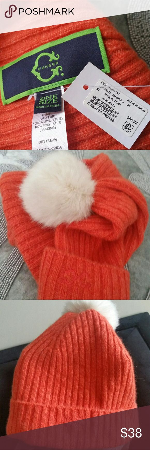 Cashmere Hat Tangerine colored cashmere hat with faux fur pompom. New with tags. Wonder Accessories Hats