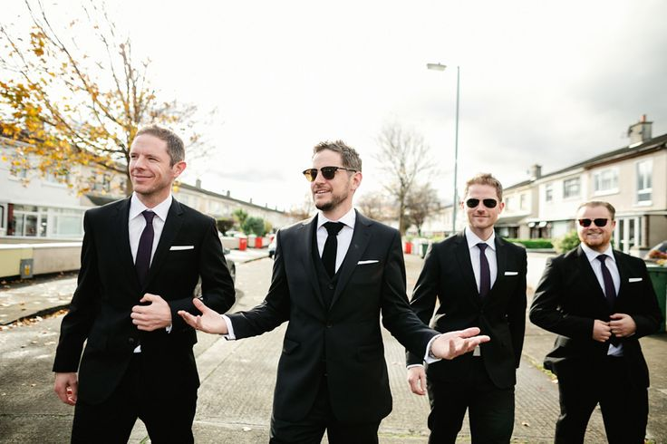 Black Tuxedo style suits with black ties & white pocket squares - The Lou's Photography - Bespoke Low Back Embellished Wedding Dress with Purple Bridesmaid Gowns for an Elegant Irish Wedding in Autumn with Pumpkins & Halloween Theme.