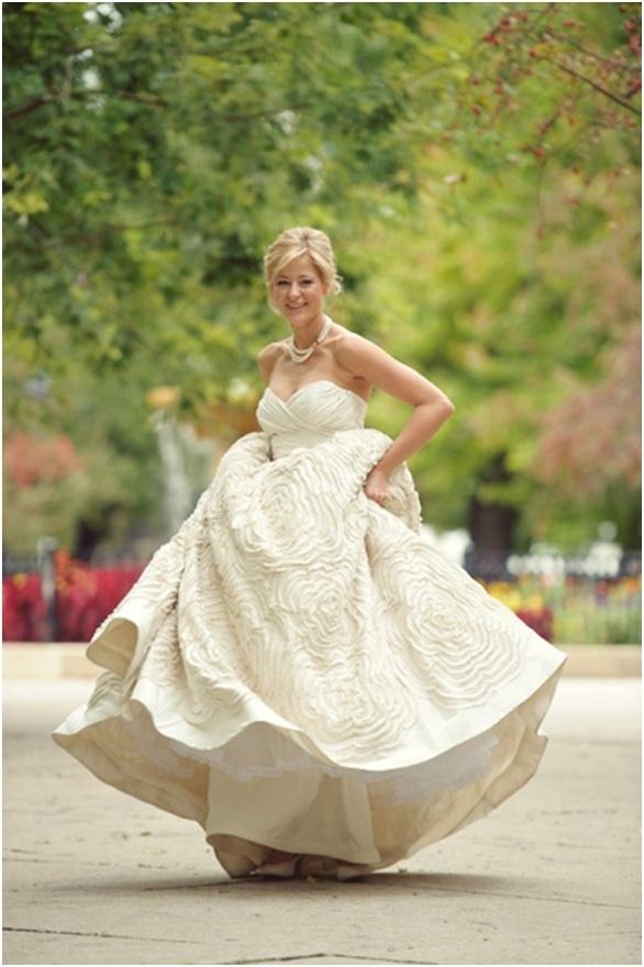 bride twirling in ruffled wedding gown #wedding