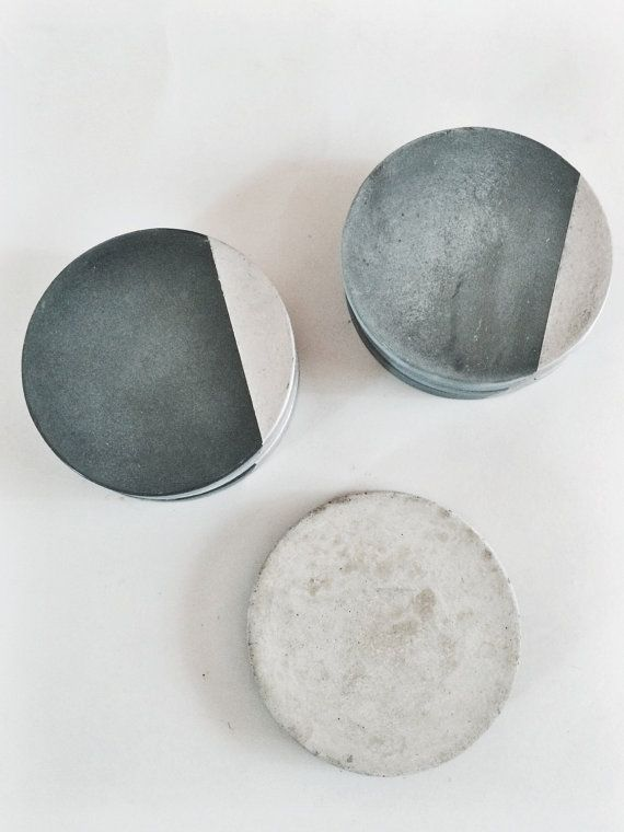 Hand poured concrete coasters. Each one is hand poured, sanded, gilded and sealed.Finished with silicone bumpers on the bottom.   4.25 inches  * As