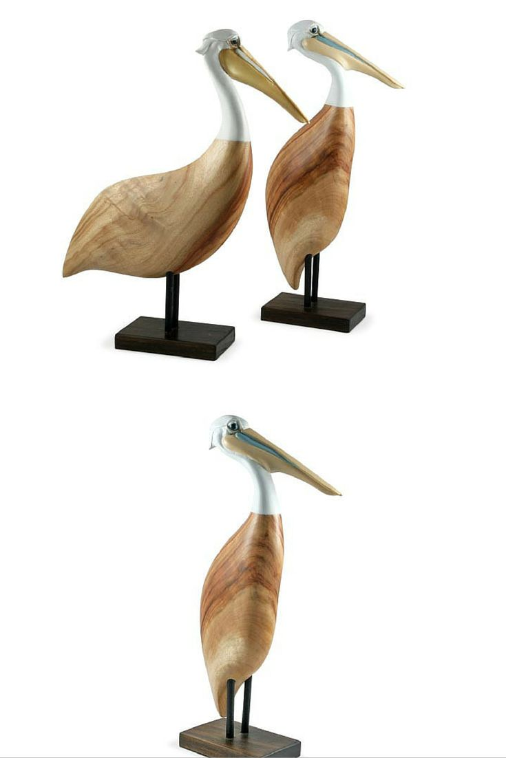 """Represented here as """"Pelican Standing Tall"""" this carving has all of the special character and personality typical of Pelicans and those smiling eyes. The body of the bird is made from sustainable, beautifully hand crafted Camphor Laurel and the head from resin and hand painted"""