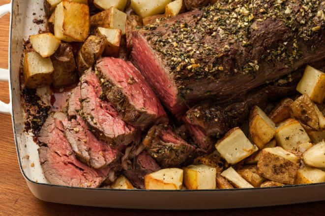 This easy beef tenderloin recipe has a garlic, thyme, and rosemary herbed butter rubbed on the outside of the beef before it's roasted.