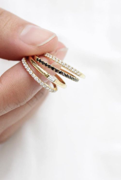This delicate ring features a single, baguette cut diamond channel set in a 14k solid gold band. It can be stacked with others, such as our skinny stacking rings, yet is strong enough to make a statem