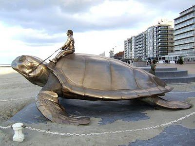 'Searching for Utopia' - bronze sculpture by Jan Fabre, Belgian contemporary painter and sculptor | Nieuwpoort promenade, Belgium, North Sea coast.