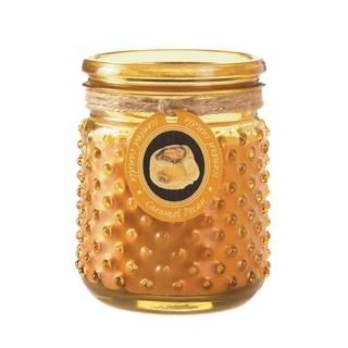 The next best thing to having a decadent dessert baking in the kitchen is the aroma of a decadent dessert baking. This charming hobnail jar houses a candle that