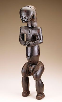 Unidentified Fang artist (Ntumu group); Equatorial Guinea or Gabon, Sculptural Element from a Reliquary Ensemble: Seated Figure,before 1916, Wood, oil, H. 58.7 cm), National Museum of African Art Smithsonian Institution, Washington, D.C., Gift of  Eugene and Agnes E. Meyer Foundation (72-41-3), Photograph by Frank Khoury.