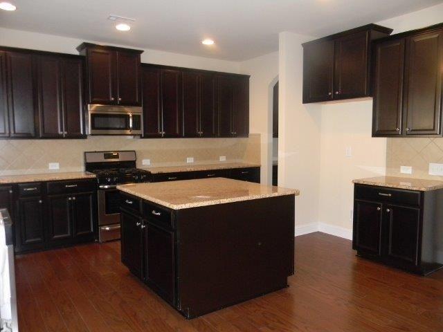The Wakefield Kitchen with Island. Timberlake Tahoe Maple Espresso Cabinets.  Giallo Ornamental Granite.