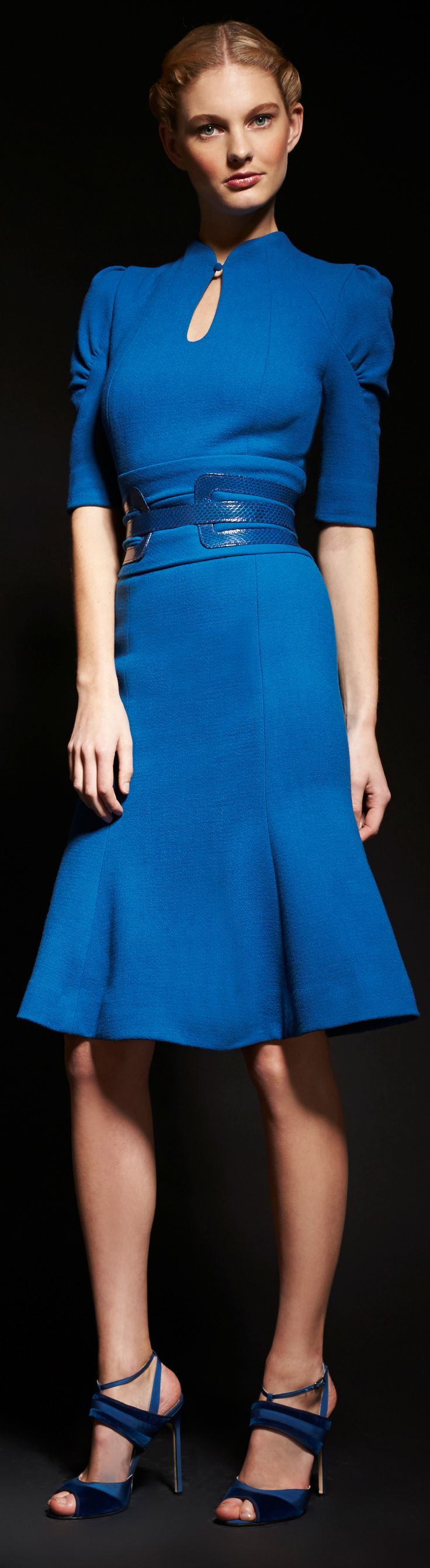 Carolina Herrera Fall 2013. Cobalt blue dress with puffed sleeves, keyhole neck, wide belted waist, and godet skirt. Two-tone blue sandals.