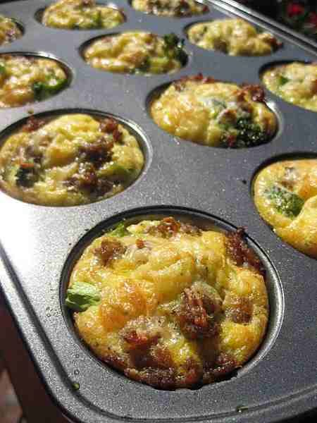 Scrambled eggs, bacon, cheese, & green onions in a muffin tin