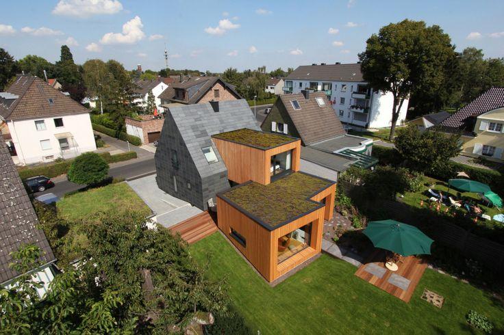 In der Reihe - aus der Reihe. Metamorphose eines kleinen Siedlungshauses. - Sanierung Siedlungshaus in Grevenbroich