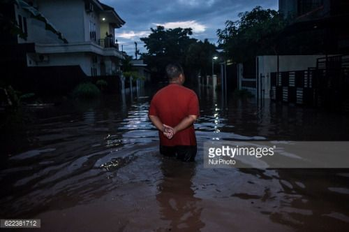 A man walk in flooded area in Yogyakarta, Indonesia, on November... #badherrenalb: A man walk in flooded area in Yogyakarta,… #badherrenalb