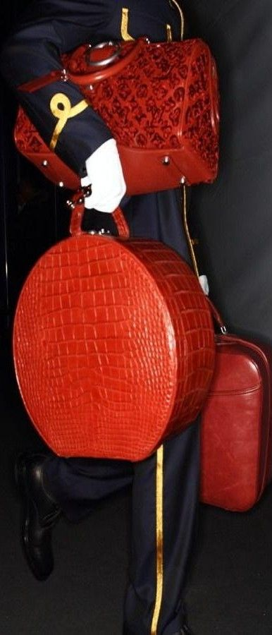 LV luggage in Red