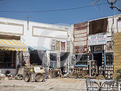Street with shops and bazaar  beside Roman biggest amphitheater in africa in El Djam, Tunisia. Africa