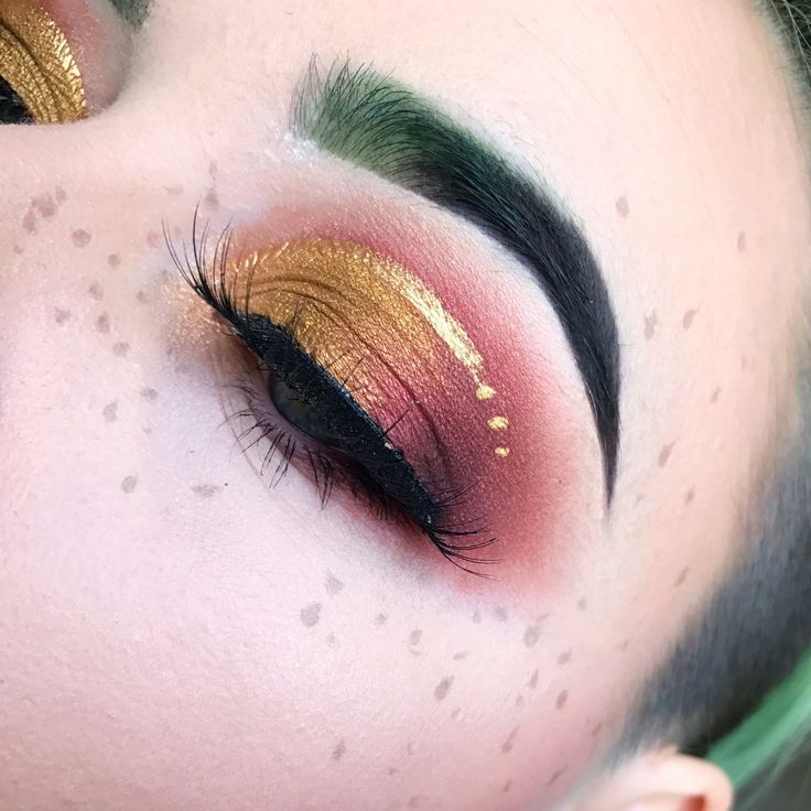 Metallic yellow gold and cranberry Eyeshadow look. I love the clashing colours!