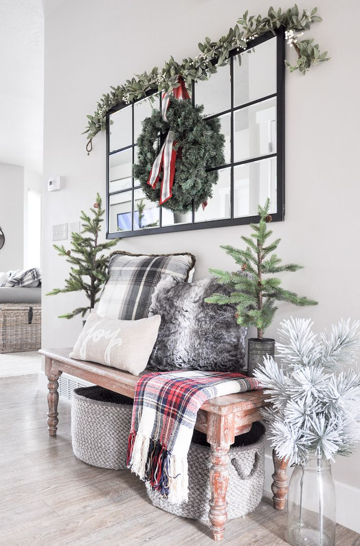 Come tour our Cozy Christmas Entryway decorated with comfy pillows, blankets and even a little hidden shoe storage!