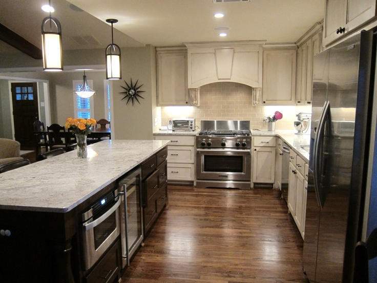 transitional kitchen, like the warming draw and wine fridge in this island