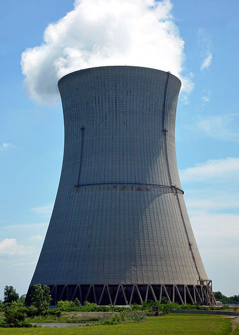 Why do nuclear power stations have cooling towers in that weird half-hourglass shape?