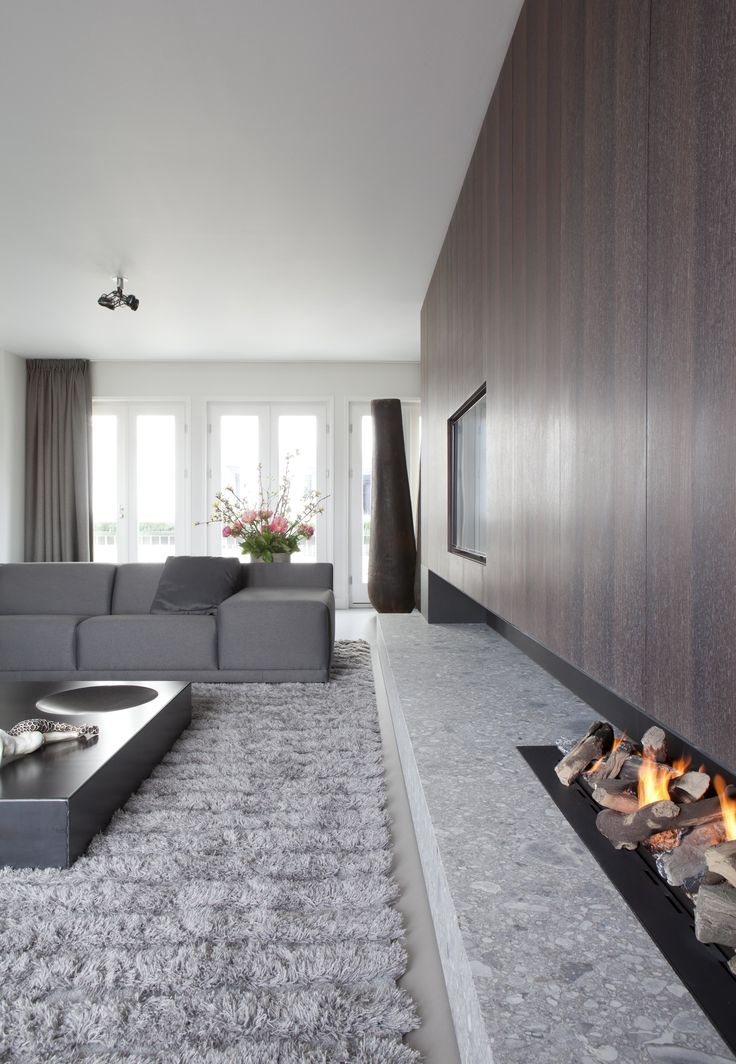 Living room in a private penthouse in Amsterdam. Lights: Modular Lighting Instruments' Nomad. Fireplace: Remy Meijers. #supermodular