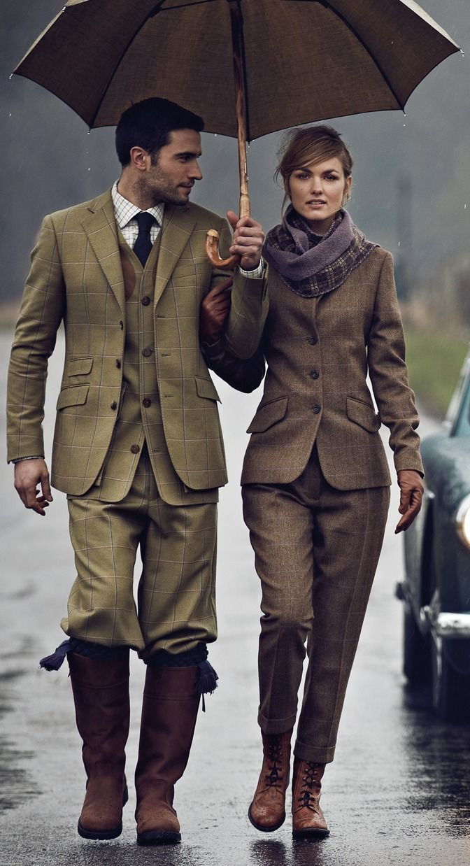 man woman umbrella, couple matching three piece suits. english country, london