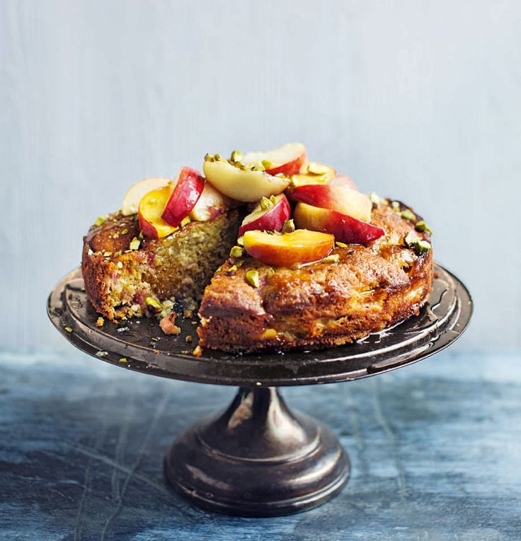 Fragrant, ripe fruit stars in this moreish, succulent warm peach, pistachio and honey cake recipe.