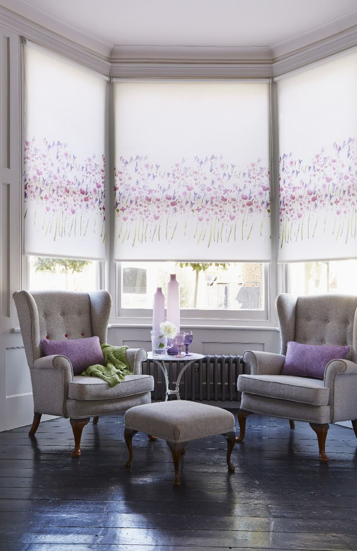 Our Watercolour Violet Roller blind features a gorgeous painterly design. It's the loveliest way to bring florals into your home. The border pattern would finish off a dining room beautifully, or add a pretty feel to a bedroom. It's perfect used in a bay window too, as we've demonstrated here. www.web-blinds.com web-blinds.com