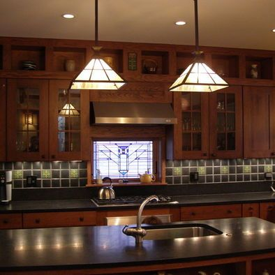 Craftsman backsplash ideas...recessed under cabinet lighting with stain glass covers! Genius!!