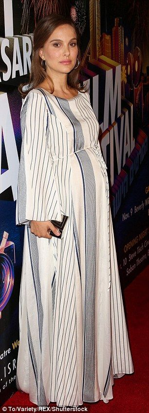 Baby on board! The expecting 35-year-old covered her bump in a belted white-striped gown featuring belled sleeves selected by stylist Kate Young