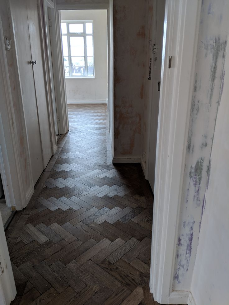 Increase the feeling of space in smaller properties by running flooring seamlessly throughout without a threshold border dividing up the rooms.  This is what we did in this Wimbledon flat when we fitted this lovely dark aged parquet.
