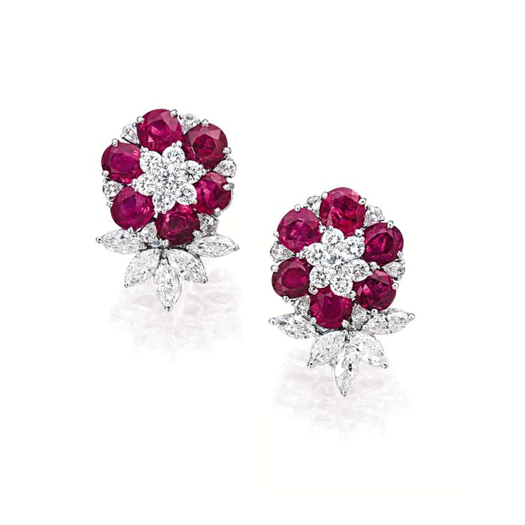 PAIR OF RUBY AND DIAMOND 'FLORAL' EARRINGS. Each composed of six oval- and cushion-shaped rubies altogether weighing 12.05 carats, decorated by brilliant-cut and marquise-shaped diamonds altogether weighing 3.60 carats, mounted in 18 karat white gold.