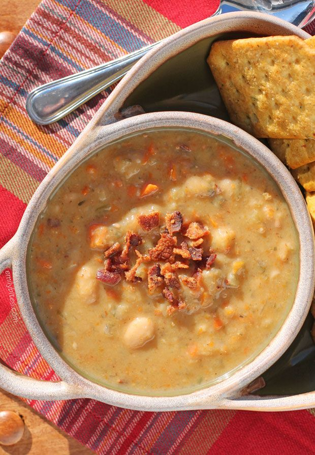 Slow Cooker White Bean SoupCome in from the cold to a hot and steamy bowl of this rustic, hearty Slow Cooker White Bean Soup with bacon. So easy to make and under 200 calories a bowl! www.emilybites.com #healthy