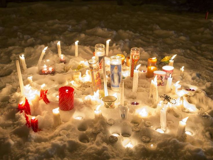 La Loche - A collection of candles from a vigil near where RCMP are on the scene after a school shooting at La Loche Community School on Friday, January 22nd, 2016.
