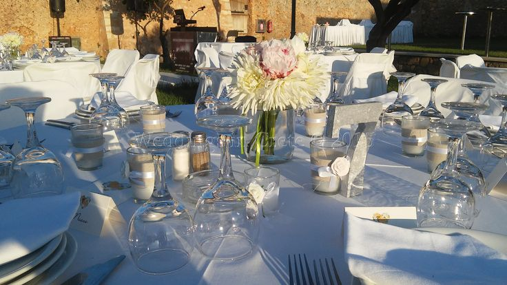 Flowers, candles, menus, name cards... - by Weddings in Crete