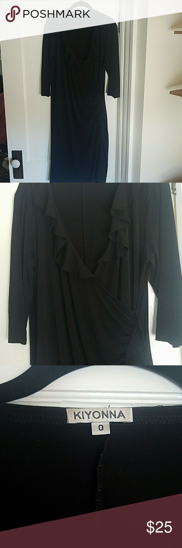 Kiyonna Perfect Little Black Dress Size 0 (10-12) Little black dresses never go out of style, even if they're discontinued like this little lady!  Old school Kiyonna LBD in their Size 0 (10-12).  Cinch waist with soft ruffle along plunging neckline and down the side slit.  Hits below the knee, 3/4 sleeves.  Stretchy so it hugs every curve just right! Kiyonna Dresses