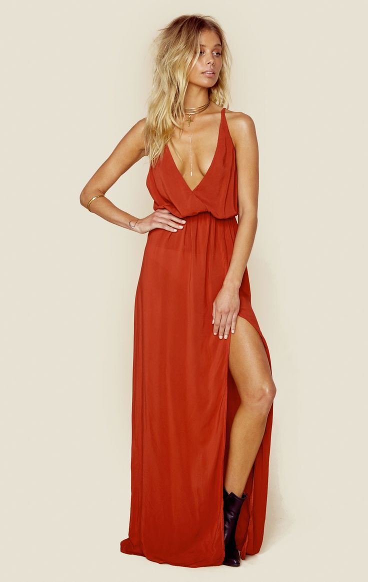 """<p class=""""product-desc-body"""">The High Tide maxi dress features a burnt rust color on a slinky rayon fabrication, crossover bodice with deep V-neck, adjustable spaghetti straps, cinched waist and super high slit at front left. So cool and boho with a pair of sandals or booties.</p><!---  fit guide ---></p><ul class=""""product-desc-list""""><li>Made in USA</li><li>Dry Clean Only</li><li>100% Rayon</li></ul><p class=""""product-desc-head"""">Fit Guide:</p><ul  class=""""product-desc-list""""><li>Model is 5ft 7…"""