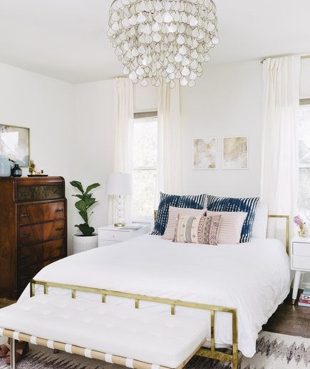 Build a Summer-Ready Bed | As the weather heats up, the cozy bedroom that was your sanctuary for three-quarters of the year may suddenly leave you tossing and turning all night. To create a bedroom that's a summer oasis (read: cool and comfortable), you'll want to swap out the warm winter bedding, lighten up the heavy window treatments, and infuse the whole space with a light and airy look. Besides making your room simply look cooler, little design updates, such as a stylish tabletop fan or