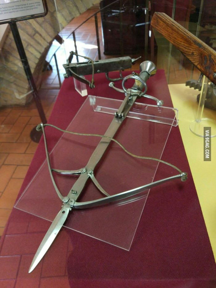 Saw this in a museum today. Does somebody know what this is? This is a crossbow that can be hidden in a sword sheath!