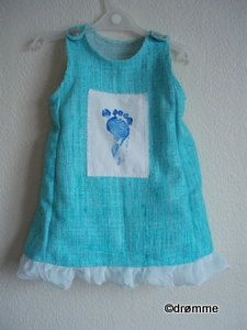 Christening dress with big brother's footprint