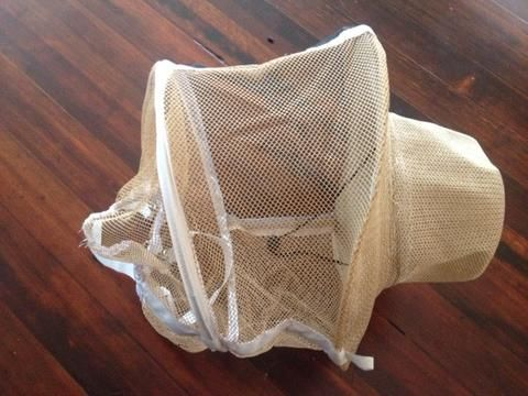 BEEKEEPERS HAT/VEIL It is always better to work with the right equipment! Check out our Commercial Grade Beekeeping Hat/Veil. Drawstring on the bottom to keep you comfortable.