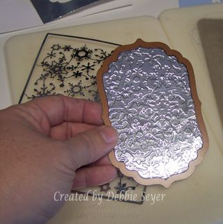 Foil Embossing Tutorial // tin foil glued to cereal box cardboard then embossed