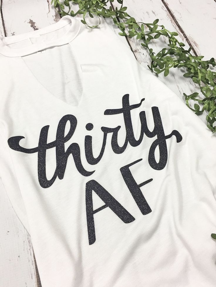 Thirty AF - Flowy Cut VNeck.  Can be customized.  Up your tank game with this sleeveless style from our Fast Fashion collection. This online exclusive style features a relaxed fit with a cut out v-neck detail and raw edge sleeves. Made in super soft poly-viscose material, this is one tank you won't want to take off.