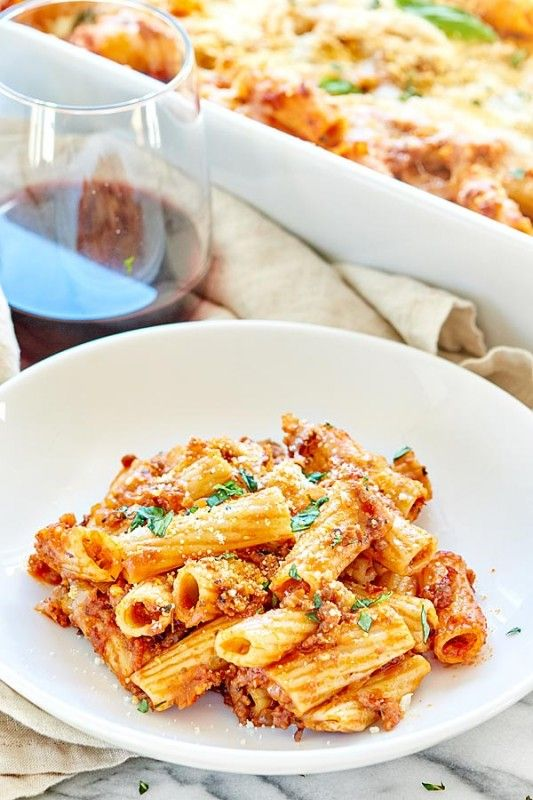 This Spicy Sausage Rigatoni is a simple, hearty, cozy fall dinner! It's made with rigatoni, a homemade spicy sausage marinara, and smothered in mozzarella!
