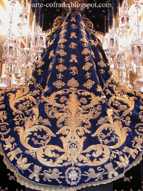 embroidered in gold on blue velvet made in the workshop of Patrocinio Lopez.